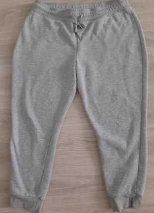 Серые спортивные штаны джоггеры  с манжетами
