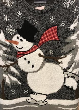 Нереально крутой брендовый вязаный свитер со снеговиком.7 фото