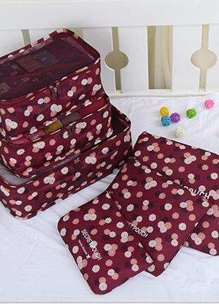 Набор дорожных сумок из шести штук бордовый в цветы.