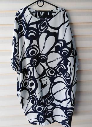 Красивое платье с карманами и манжетом внизу