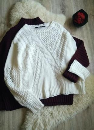 Очень красивый белый ажурный свитер оверсайз с косами линия плеча спущена