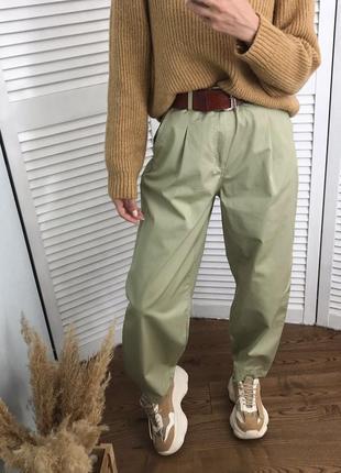 Котонові фісташкові брюки-слоучі