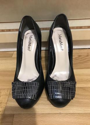 Кожаные чёрный туфли