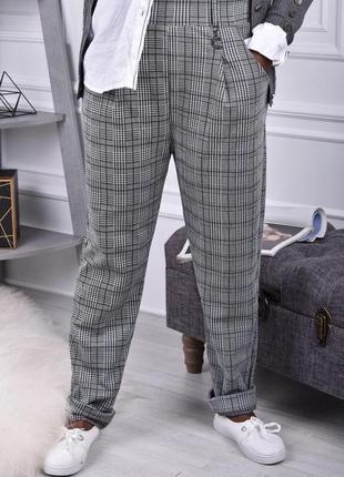 Тренд сезону стильні брюки в клітинку батал