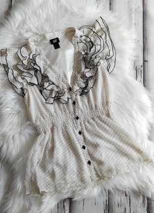 Романтическая блузка в горох с рюшами