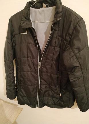 Демисезонная теплая спортивная куртка umbro черный 10-12 лет 146