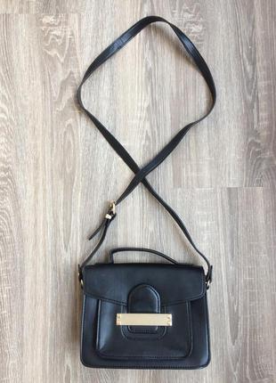 Вмістка чорна сумочка із золотою фурнітурою від next (замінник)