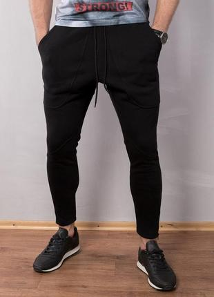 Черные утепленные штаны зауженные