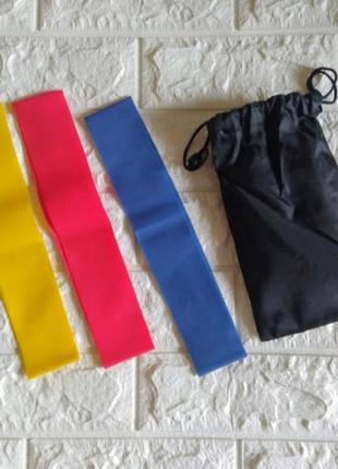 Три резинки для фитнеса разной плотности в удобном чехле