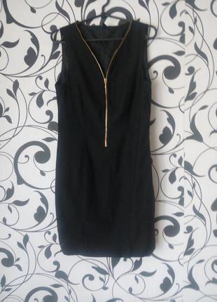 Элегантное платье с регулированым декольте