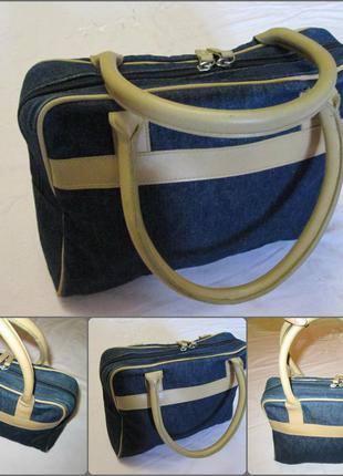 Стильна джинсова сумочка з шкіряними ручками.