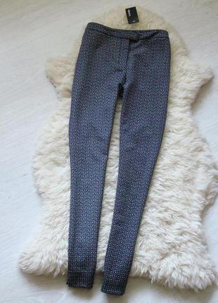 Новые брюки с биркой