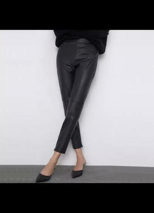 Новенькие и очень стильные штаны из кожзама. размер м