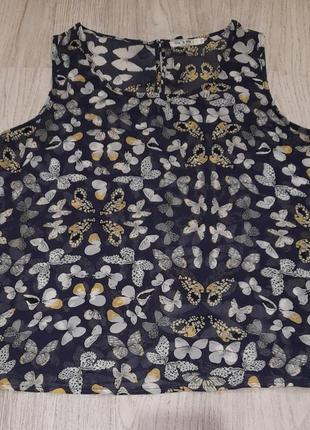 Блузка в бабочки на спине с бантиками