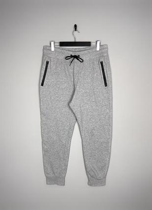 H&m трикотажні спортивні штани в сірому кольорі, мають кишеньки на замочках.