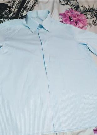 Голубая рубашка в полоску с коротким рукавом на мальчика лет 9-11