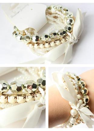Комплект белых браслетов с лентой