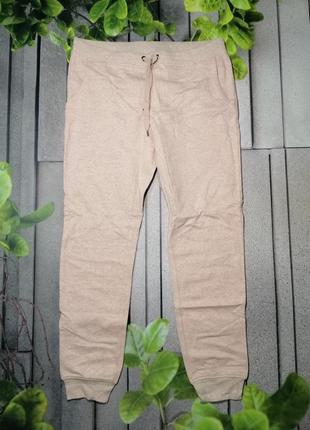 Розовые утепленные брюки с манжетами спорт стиль