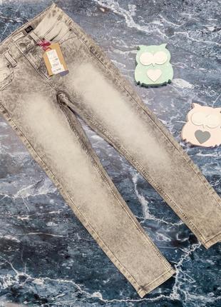 Серые джинсы ovs на девочку рост 152