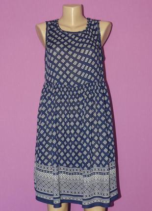 Милое легкое платьице от new look с инетесной спинкой12-14р., в идеале