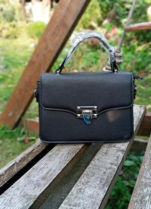 Жіноча сумка із еко-шкіри офіційного стилю