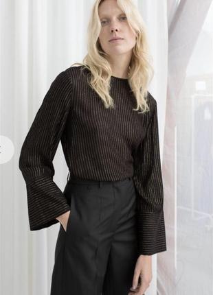 Блуза з крутими широкими рукавами