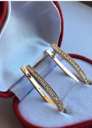 Сережки стрілки золото сонця