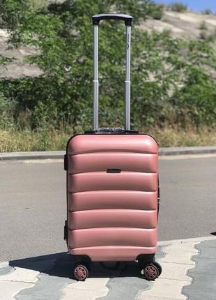 Пластиковый чемодан из поликарбоната для ручной клади розовый польша