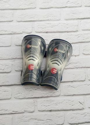 Футбольні щитки/защита на ноги erima