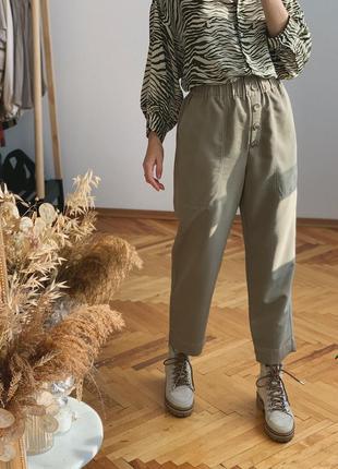Оливкові брюки