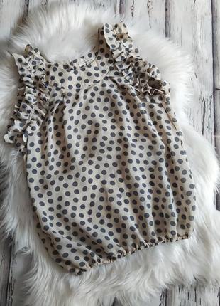 Блузка в горох с рюшами