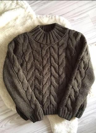 Шерстяной вязаний свитер в косу цвета хаки
