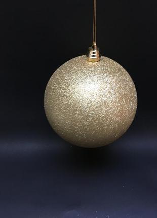 Большой золотистый шар с блестками для декора 20 см.