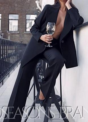 Чёрный костюм с брюками клёш