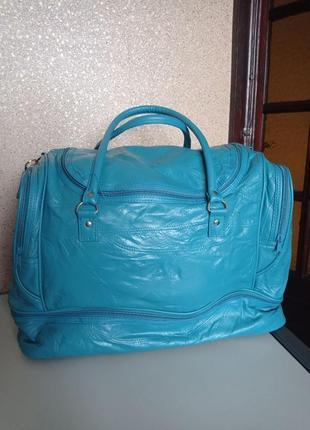 Кожаная большая  дорожная сумка.