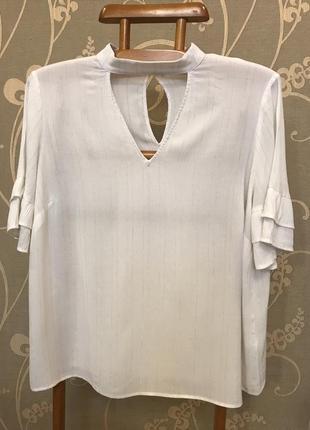 Очень красивая и стильная брендовая блузка..вискоза.