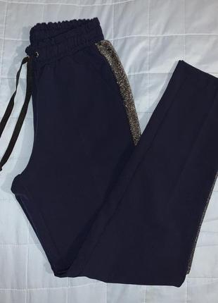 Стильні та зручні штани з люрексовими ласпасами