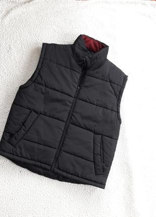 Теплая жилетка с карманами