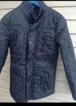 Классная фирм.стеганная куртка