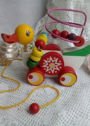 Игрушка деревянная каталка на колесиках утка на веревочке уточка
