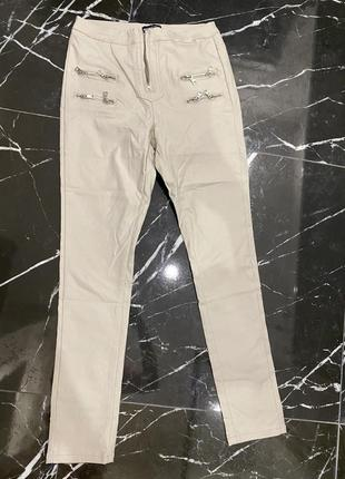 Новые бежевые брюки сломана собачка