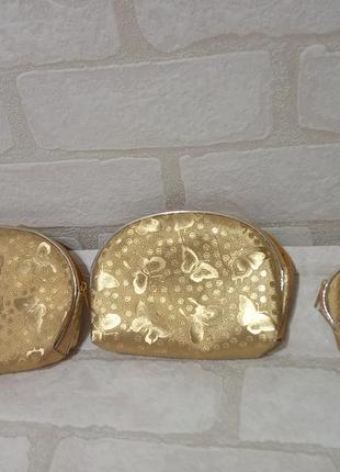 Набор косметичек. три штуки. цвет золото. идеальный подарок.