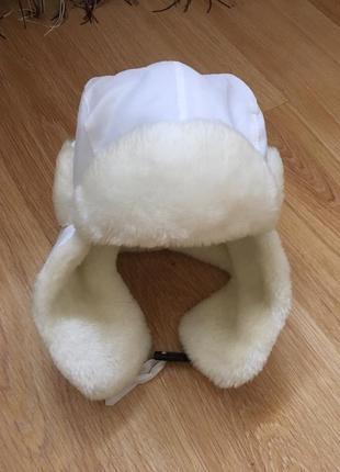 Фирменная шапка—ушанка