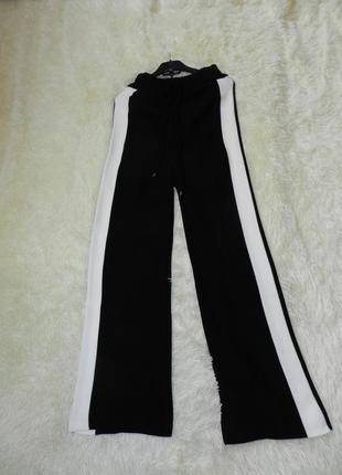 Крутые вязаные брюки кюлоты с лампасами