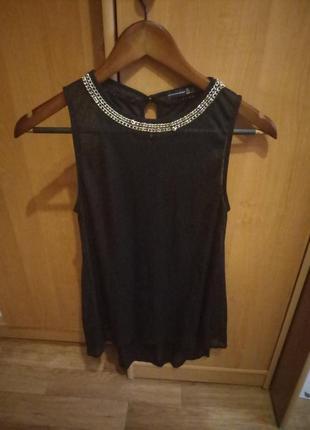Прозрачная блузка с цепочкой