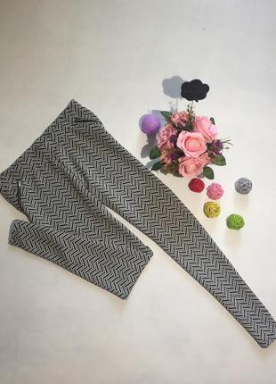 Трендовые штаны в этно принт с молниями на кармашках