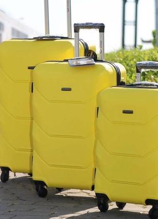 Желтый чемодан wings 147 4 размера1 фото