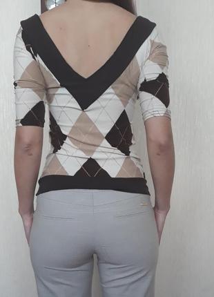 Сексуальная кофточка с красивым декольте и вырезом на спине tally weij