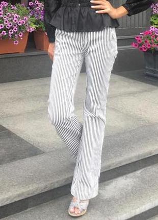 Деловые брюки клеш в полоску