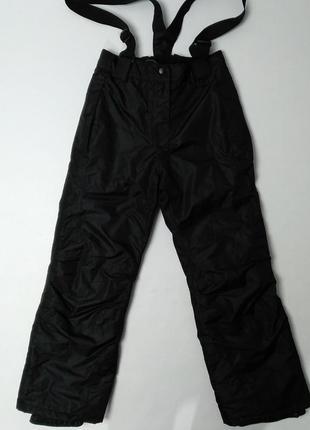 Теплые черные зимние штаны с подтяжками для мальчика crivit 134-140см